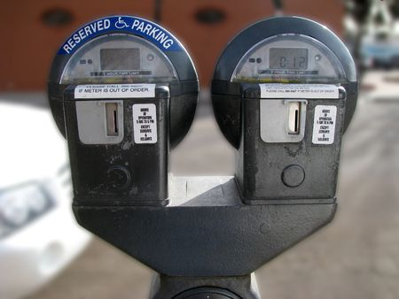 Handicap Reserved Parking Meter. Half of this meter is for those handicapped the other half is for regular parking. Stock Photo