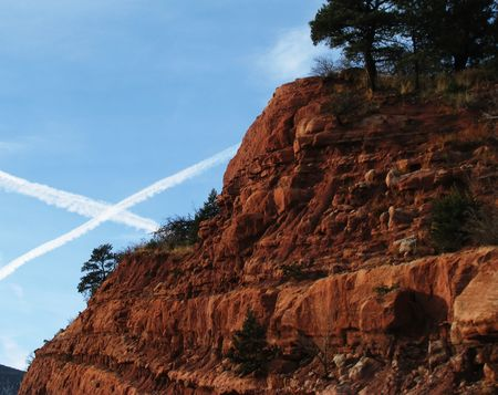 x marks the spot: X Marks the Spot ! V2 A picture of two plane trails in the sky next to a beautiful piece of Colorado landscape. Stock Photo