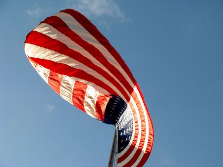 American Flag v3 with Red White and Blue colors set against a blue sky with white clouds. photo