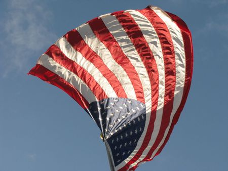 American Flag v4 with Red White and Blue colors set against a blue sky with white clouds. photo