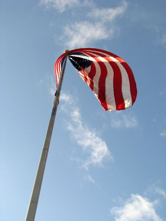 American Flag v1 with Red White and Blue colors set against a blue sky with white clouds. photo