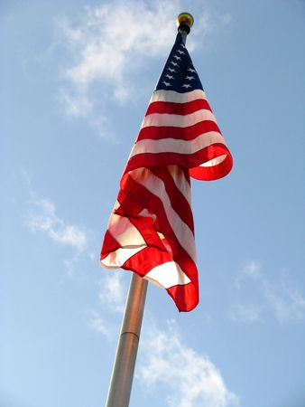 American Flag v2 with Red White and Blue colors set against a blue sky with white clouds. photo