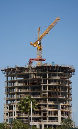 contruction: Business Building Contruction Crane is at the top of a new high rise project in St. Petersburg, Florida Stock Photo