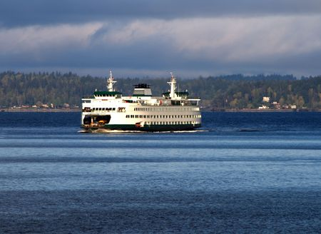 captured: Puget Sound Ferry v1 is one of the many Ferries in the state of Washington captured near Seattle. There is a cloudy sky which is common sight for the region.   Stock Photo