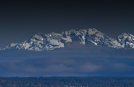 representations: Olympic Mountains Picturesque v1 is an abstract conceptual representation of the sky above the western shores of Washingtons Puget Sound. Stock Photo