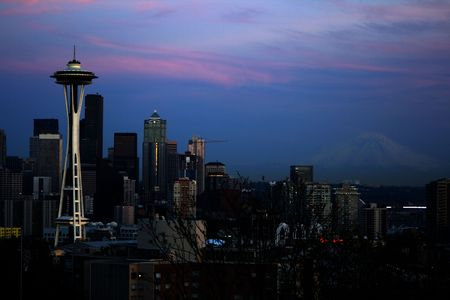 Seattle Space Needle and Mt. Rainier captured from on the hill of Queen Anne at Kerry Park. The setting sun casta a glow on the downtown skyline on top of the mountain and across the puget sound sky Stock Photo - 3062032