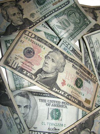 moola: Pile of US Dollars on White background.