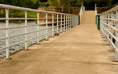 hand rails: Boardwalk Over Water v1 is a long walkway extending onto Lake Washington Stock Photo