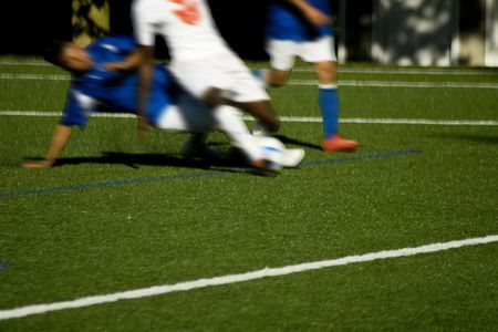 action blur: Soccer Tackle Competition Action Blur on a Soccer Field of artificial turf