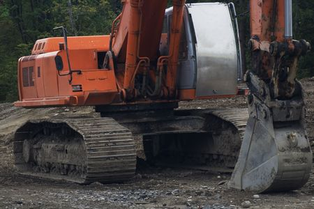 Heavy Construction Backhoe v1 is ready for a excavation project. Фото со стока