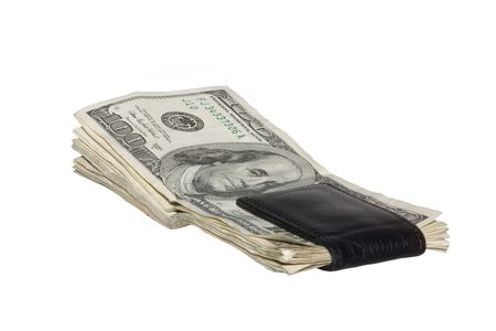 US One hundred dollar bills in black money clip. The money is faded and worn.