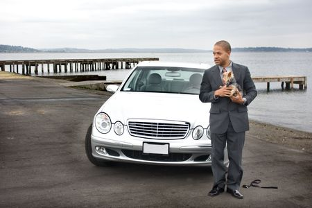 Business Man Luxury Car and Dog at Lake next to a pier.