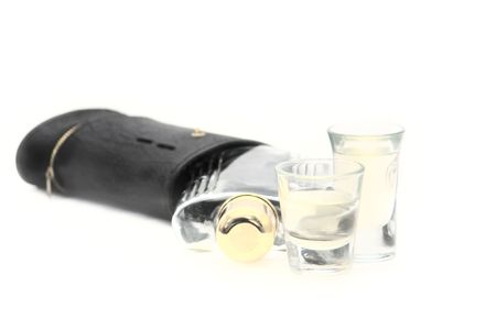 Isolated shot glasses whiskey alchohol flask and case. Please dont drink and drive. Stock Photo