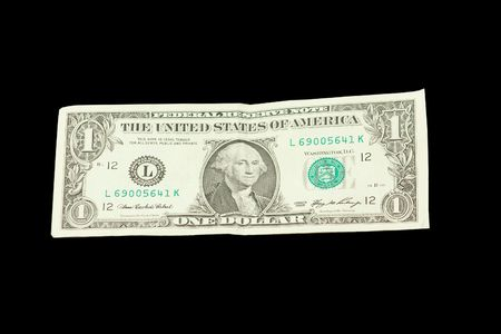 circulated: US One Dollar Banknote Currency on a Black background. Stock Photo