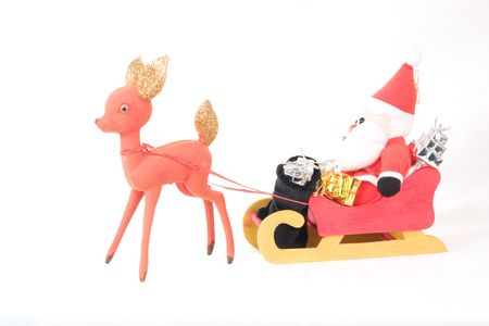Santa Claus Sleigh and Reindeer with presents and gifts. photo