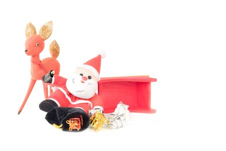 Reindeer and Drinking Santa Claus Sleigh Accident with bag of packages spilled onto the snow white background. photo