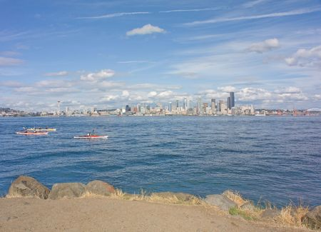 puget: Seattle Space Needle and Scenic Skyline with Kayakers as viewed across the Puget Sound from Alki. Stock Photo