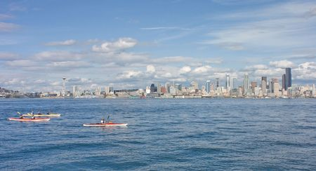 puget: Seattle Space Needle Skyline with Kayakers as viewed from across the Puget Sound at Alki.