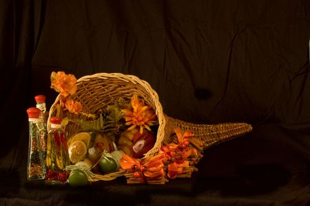 Fall Cornucopia with Seasonings and Cinamon Sticks isolated on a black background.