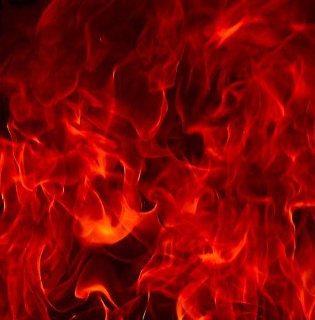 Red Fire Flames der hel tegen een zwarte achtergrond.  Stockfoto - 5693138