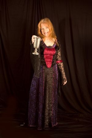 Medieval Serving Wench with Goblet isoalted on a Black Background. Stock Photo