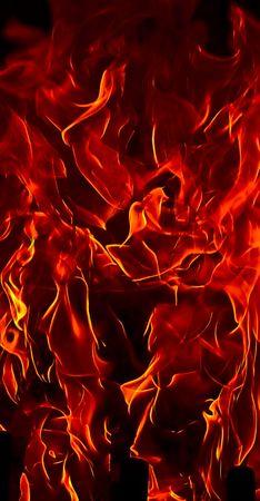 Rojo Fuego llamas del infierno contra un fondo negro.