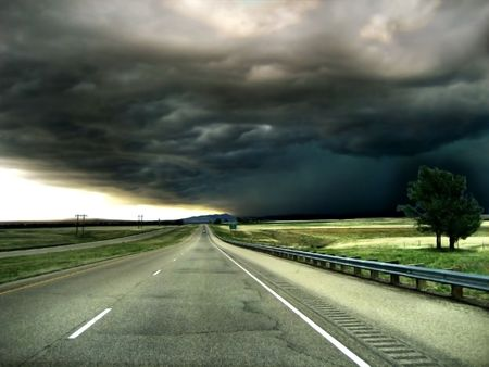 hail: Highway leading into a Storm on the Horizon Background Stock Photo