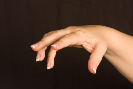 Female Hand Open Holding Nothing isolated on a black background