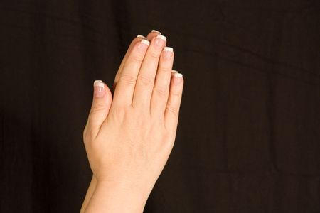 Female French Manicured Hands Praying Isolated on a black background. Zdjęcie Seryjne