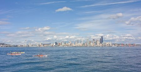 puget: Young Girl Views Famous Seattle Space Needle and Scenic Skyline from across the Puget Sound at Alki.