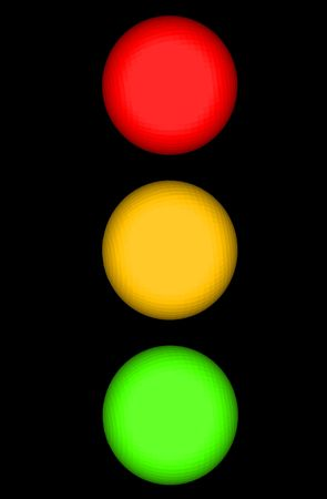 Traffic Light or Stop Light with Red Yellow and Green Illuminated Spheres with Copy Space Isolated on a Black Background Stock Photo