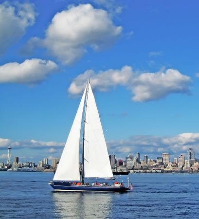 seattle: Sailboat on the Puget Sound and Seattle Space Needle in Washington State.