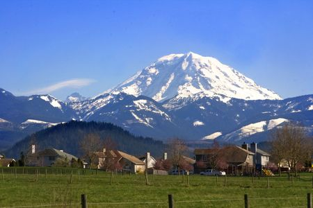 Mt. Rainier viewed from across a field near Buckley, Washington State in the Pacific Northwest part of the United States.