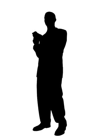 sms: Man Standing Texting on Cell Phone Silhouette isolated on a white background. Stock Photo