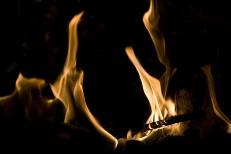 Flames of Fire in a Fireplace against a black Background  photo