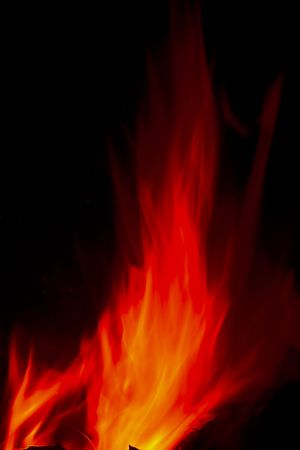 Flames Fire of Hell against a black background. Stock Photo - 6686089