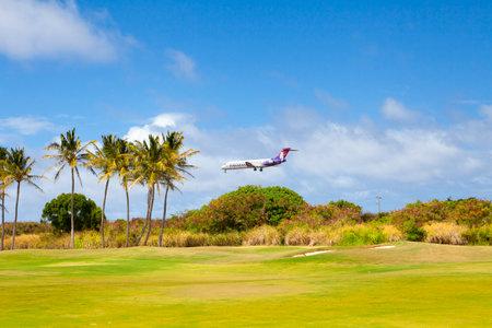 June 2012: Kawaii Island has a Hawaiian Airlines plane landing in Hawaii Kawaii with sun