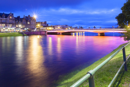Inverness - august 2014: Inverness at night Inverness is located at the mouth of the River Ness that flows into the nearby Loch Ness