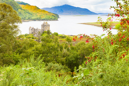Dornie Scotland - August 2014: Eilean Donan Castle is located in a strategic position at the confluence of three fjords. In August, tourists visit it because it is known as the set of one of James Bonds films