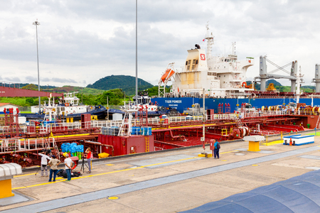 Panama Canal August 2016: In August a TV troupe and a photographer shoot the passage of a tanker to the weir of miraflores.Since the inauguration of the channel in 2016, more than one million ships have been transited because it is the shortest stretch to