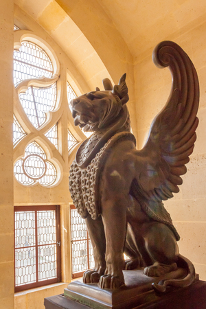 Pierrefond  September 2012 - In September tourists visit this historic castle to admire the luxurious architecture and the amazing panorama. This is the statue of a lion winged located in the interior of the castle
