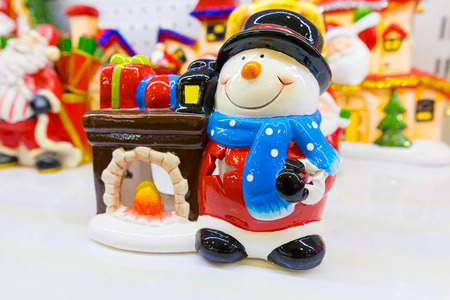 Ceramic Christmas lantern with snowman and fireplace Stock Photo
