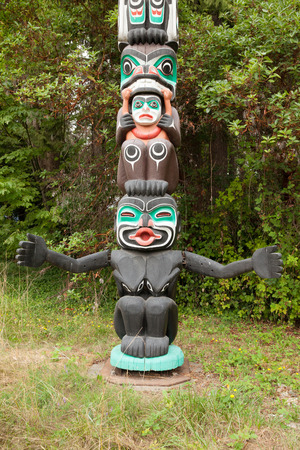 british culture: Vancouver August 2015 This is a detail of an  Indian totem that visitors can admire at Stanley Park in Vancouver to appreciate the skill of craftsmen who carved it on the wood