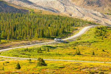 Athabasca August 2015 In this period of no snow, this bus take the tourist from the ticket office of the Athabasca Glacier in Athabasca to the parking as there starts the trail on the Glacier with big special trucks. Stock Photo