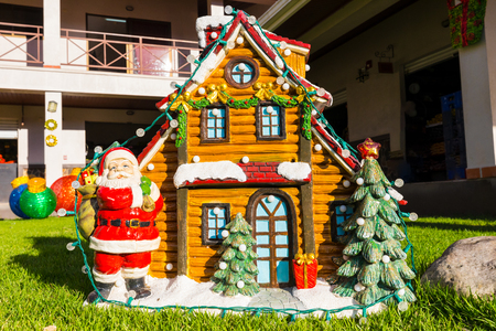 Santa Claus and little house with snow of ceramic Christmas decoration