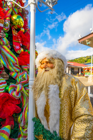 Santa Claus and Christmas tree in Boquete Town Panama with blue sky