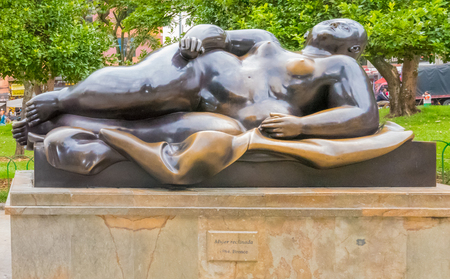 Medellin January 2018 This bronze statue representing a recumbent woman was created by the artist Fernando Botero and donated by himself to the Antioquia museum in Medellin where it is now exhibited.