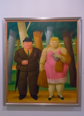 Medellin January 2018 This painting named a couple, was created by the artist Fernando Botero and donated by himself to the Antioquia museum in Medellin where it is now exhibited. Redakční