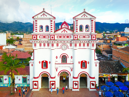 Guatape January 2018 Aerial view of the church of Guatape meeting point of locals and tourists where to pray and then have a snack in the locals neighbors Editorial