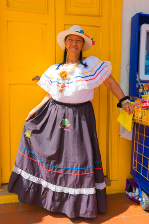 Medellin January 2018 A woman in traditional colombian dress welcomes tourists in the small village of Paisa in Medellin